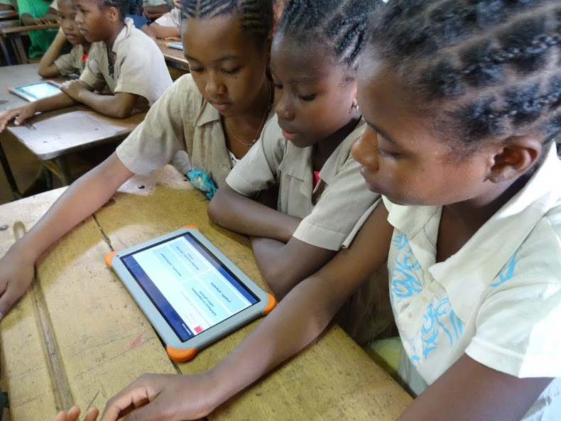Pupils following the curriculum on their tablets.