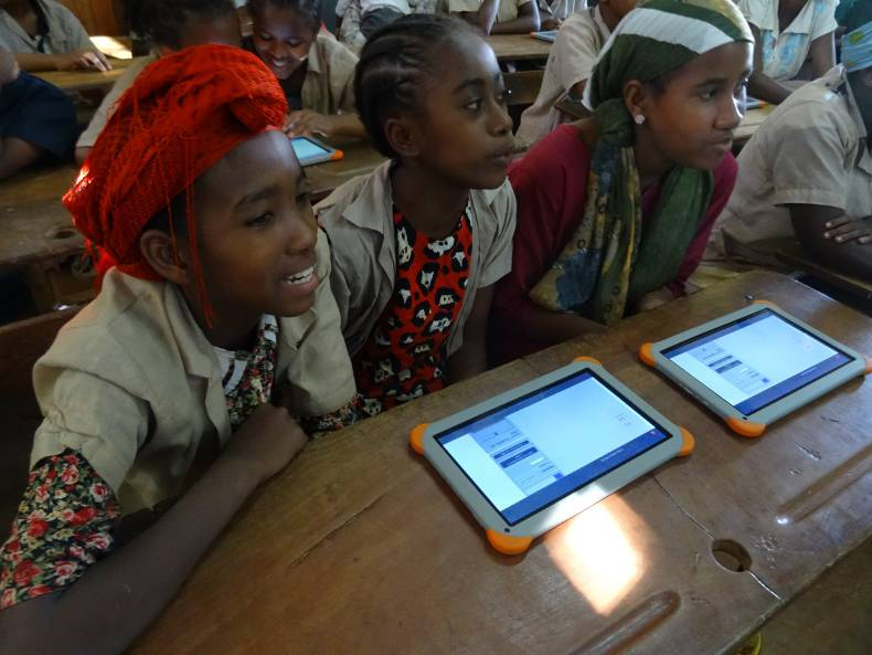 Madagascan children using tablets to access educational content